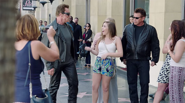 Arnold Schwarzenegger surprises a Terminator impersonator on Hollywood Boulevard.
